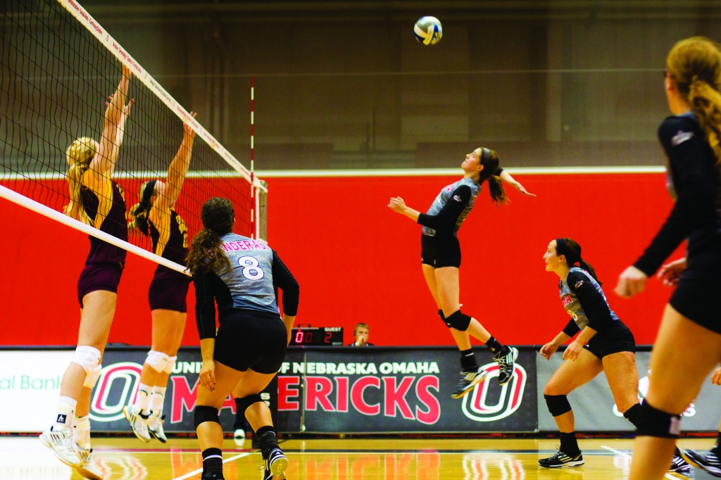 Photo by Evan Ludes/The Gateway Junior Amy Taylor had four kills against Central Michigan in the Hitlon Omaha Classic