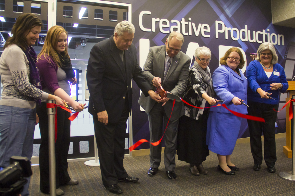 Photos by Evan Ludes/ The Gateway  Chancellor John Christenson assists with cutting the ribbon to unveil the Creative Production Lab, one of several improvements to Criss Library.