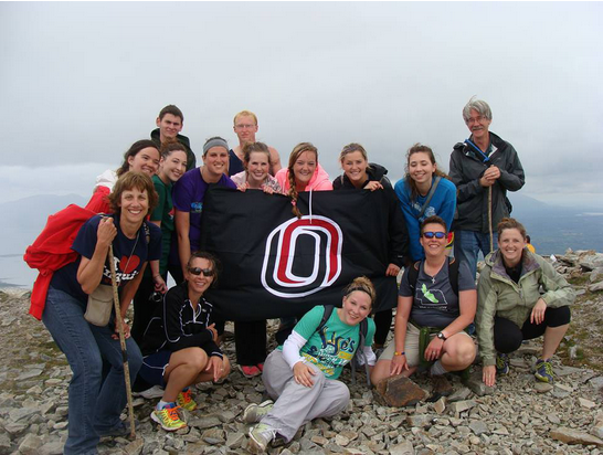 Photo courtesy of University Communications Students pose on top of a mountain, while on a trip through the study abroad program