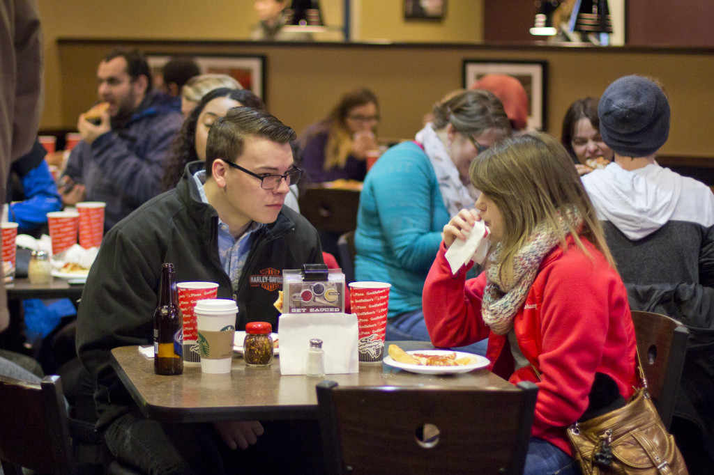 Photos by Evan Ludes/ The Gateway UNO students escaped the cold in Godfathers before the game Thursday.