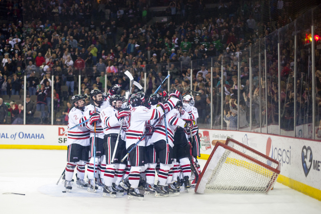 Photos by Evan Ludes/ The Gateway UNO Hockey celebrates their game-winner in front of 11,000 fans on Friday.