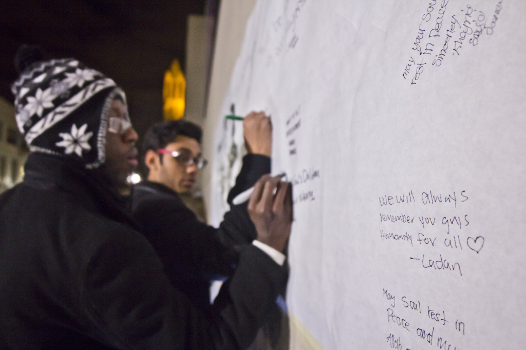 Photo by Evan Ludes/ The Gateway Students signed a board with messages for the the victims of the shooting.