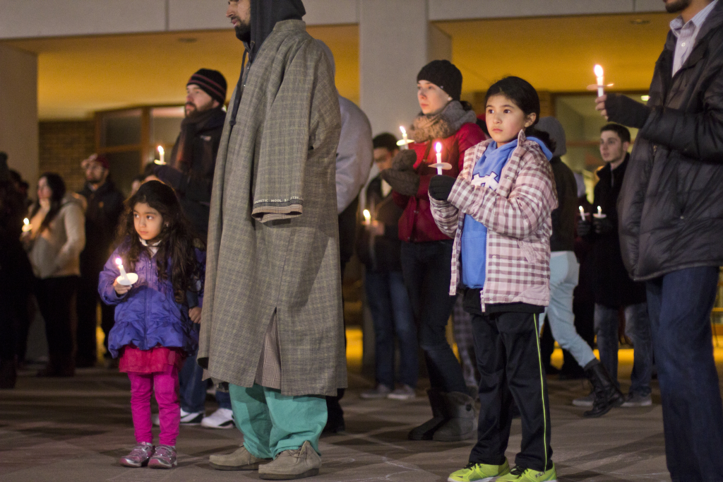 Photo by Evan Ludes/ The Gateway Members of the public, young and old, came out to remember the victims.