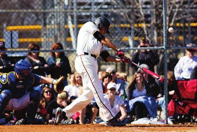 Photos by Evan Ludes/ The Gateway  Clayton Taylor blasts one in front of the Maverick faithful, he was a HR away from hitting for the cycle Sunday.