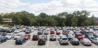 cars fill the parking lot at UNO's criss library