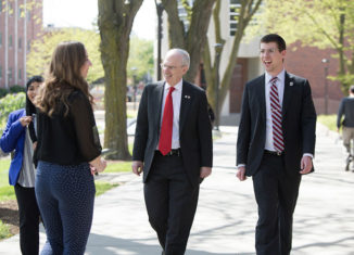 Chancellor Gold walks along UNO campus with former student body president Patrick Davlin
