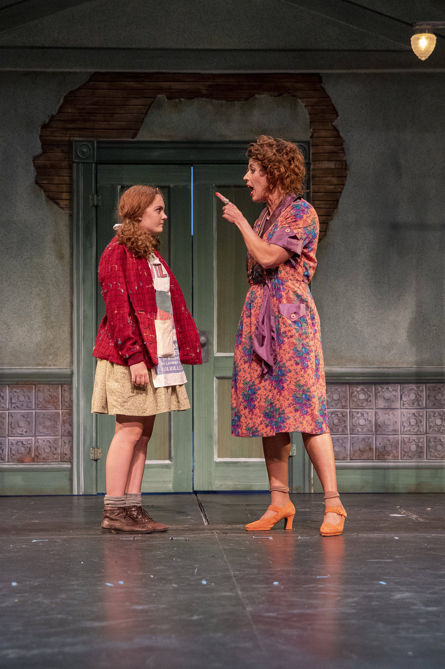 "In the production ""Annie,"" one character is seen scolding another character."