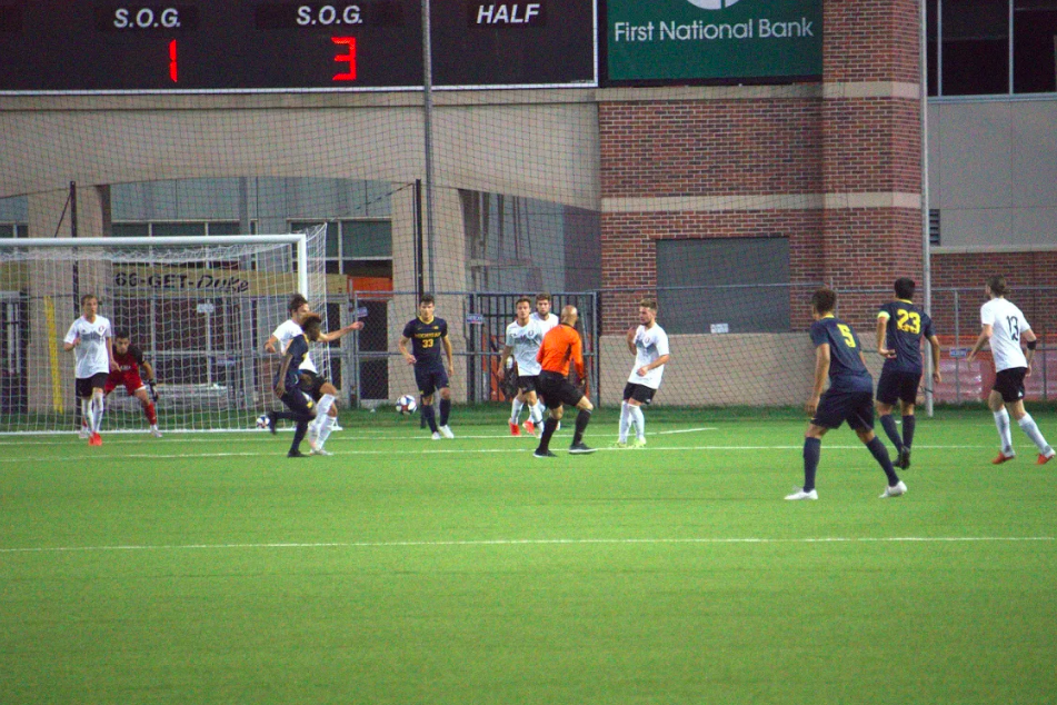 Two teams are playing soccer against each other.