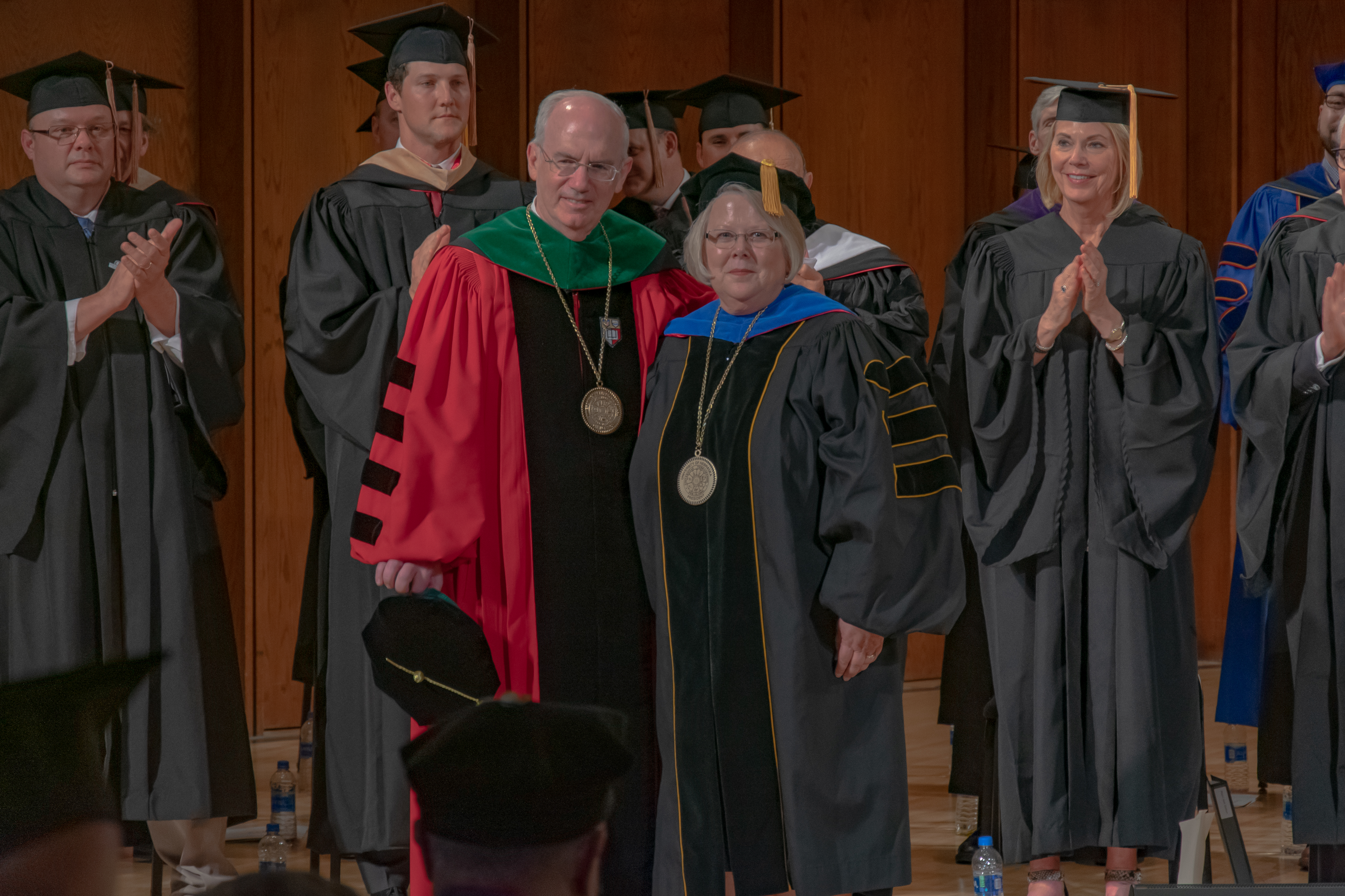 UNO Chancellor Gold and President Fritz are seen standing at Chancellor Gold's investiture.
