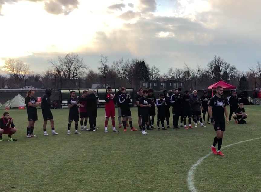 The Omaha men's soccer team standing on the field after the game