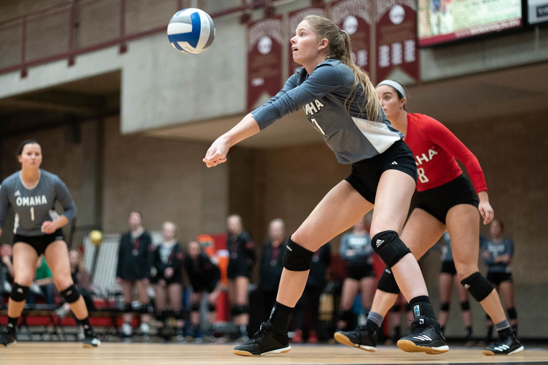 An Omaha volleyball player hits the ball