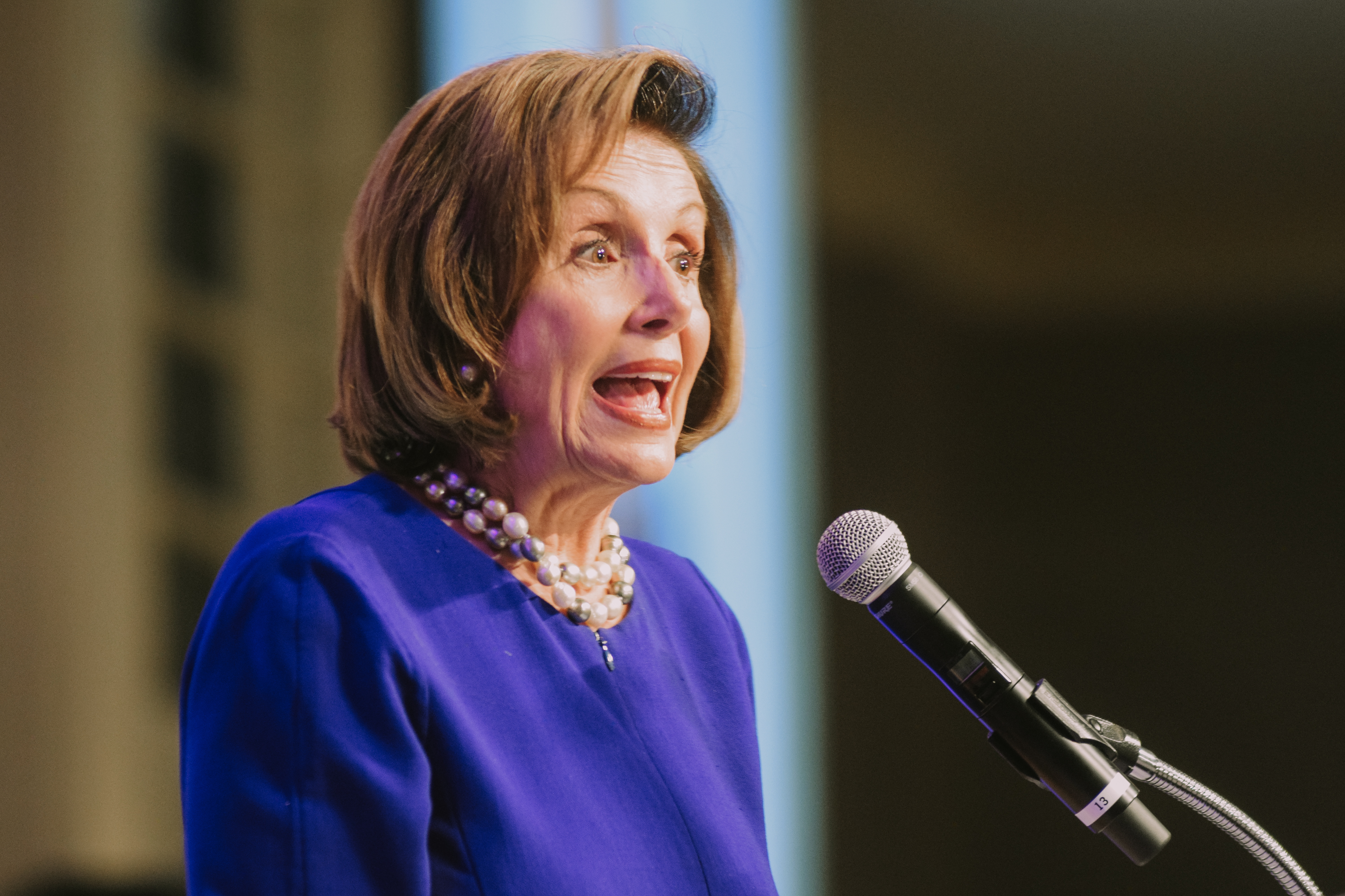 A close up of Nancy Pelosi speaking at a fundraiser in Omaha