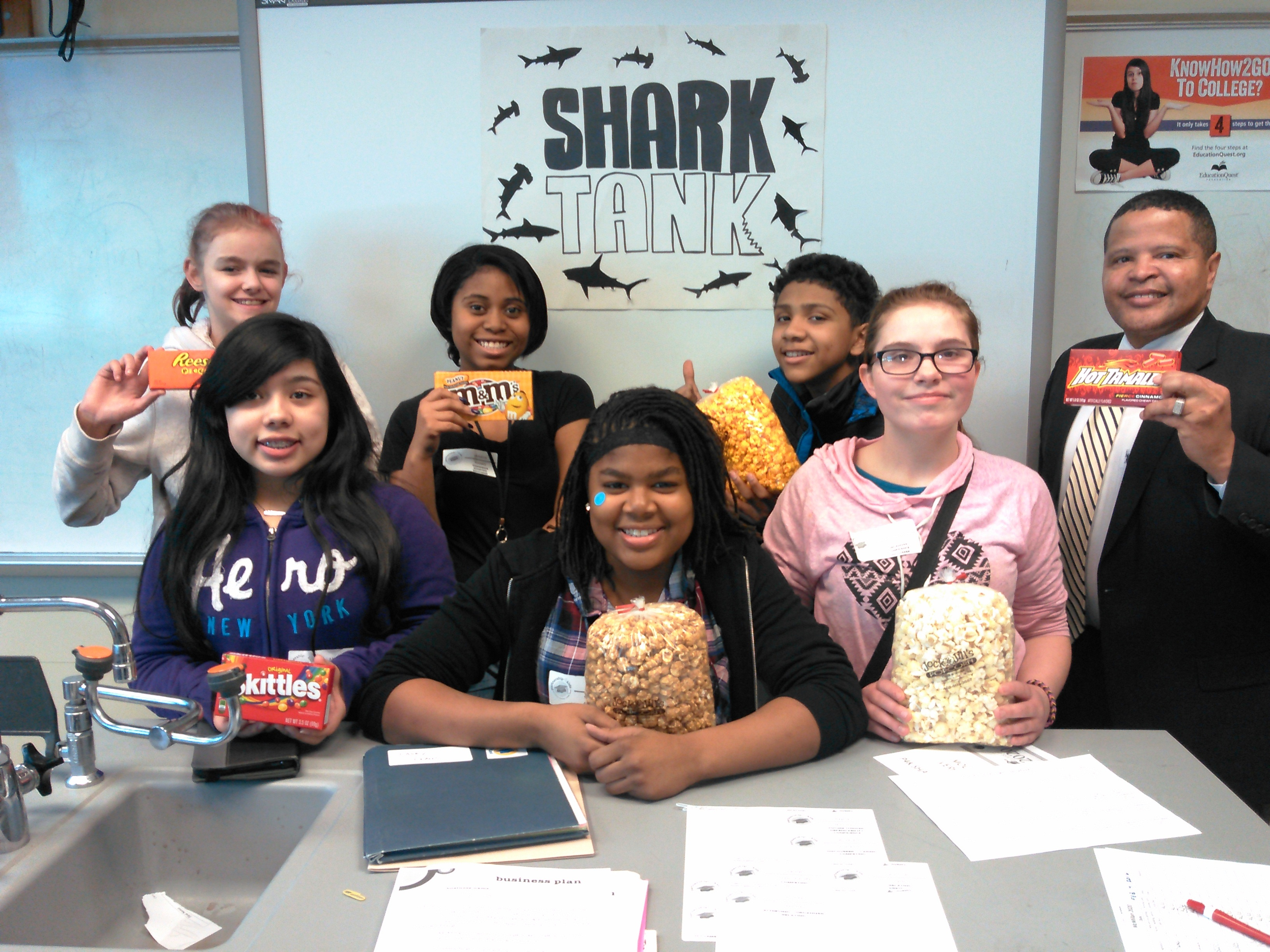 "Several kids are posing at an event for the ""Shark Tank"" program"