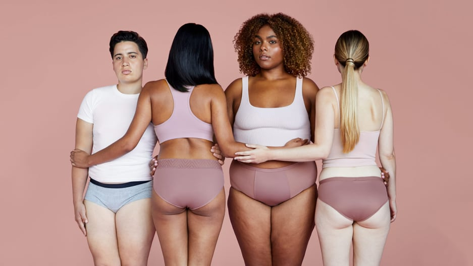 Several people are posing in underwear