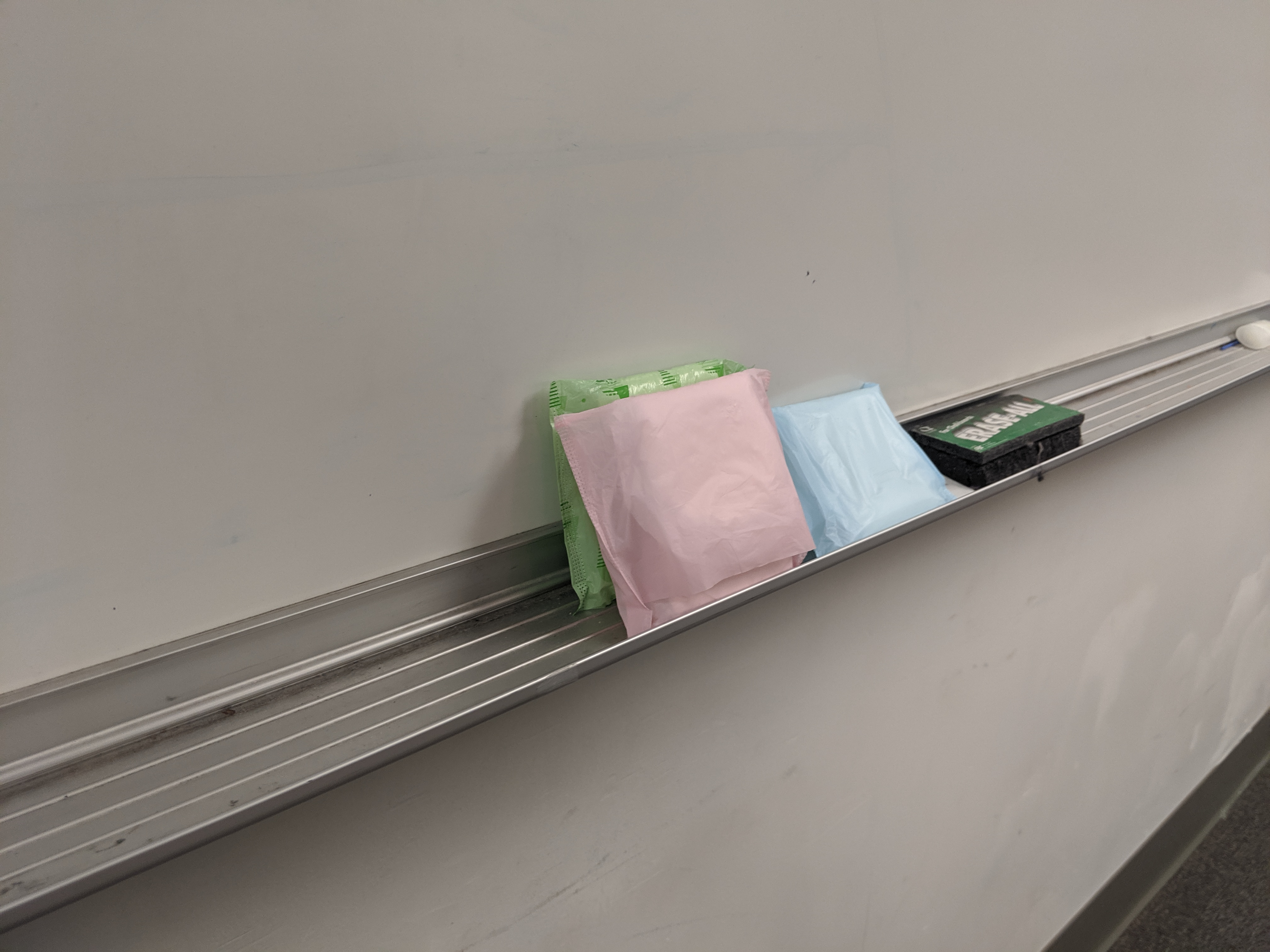 A pile of pads sitting in the overflow room at the Siena Francis House, shows how necessary access to feminine hygiene products are for homeless women.