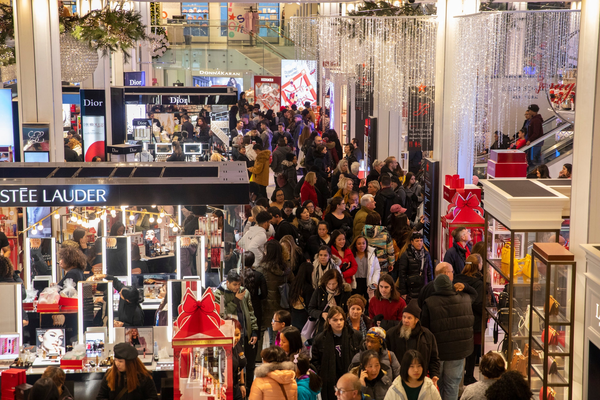 A large number of shoppers are inside of a store