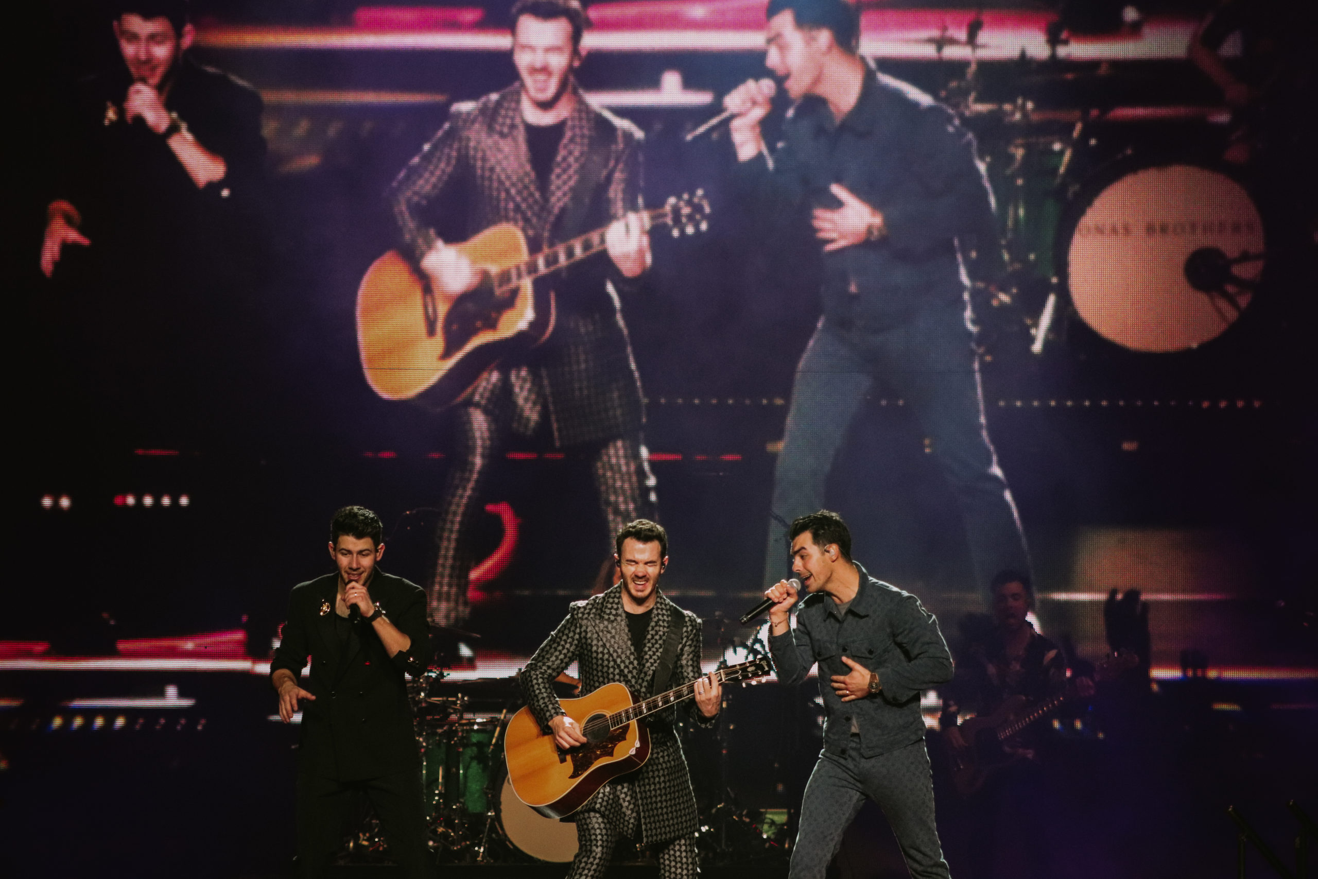 The Jonas Brothers performing on stage