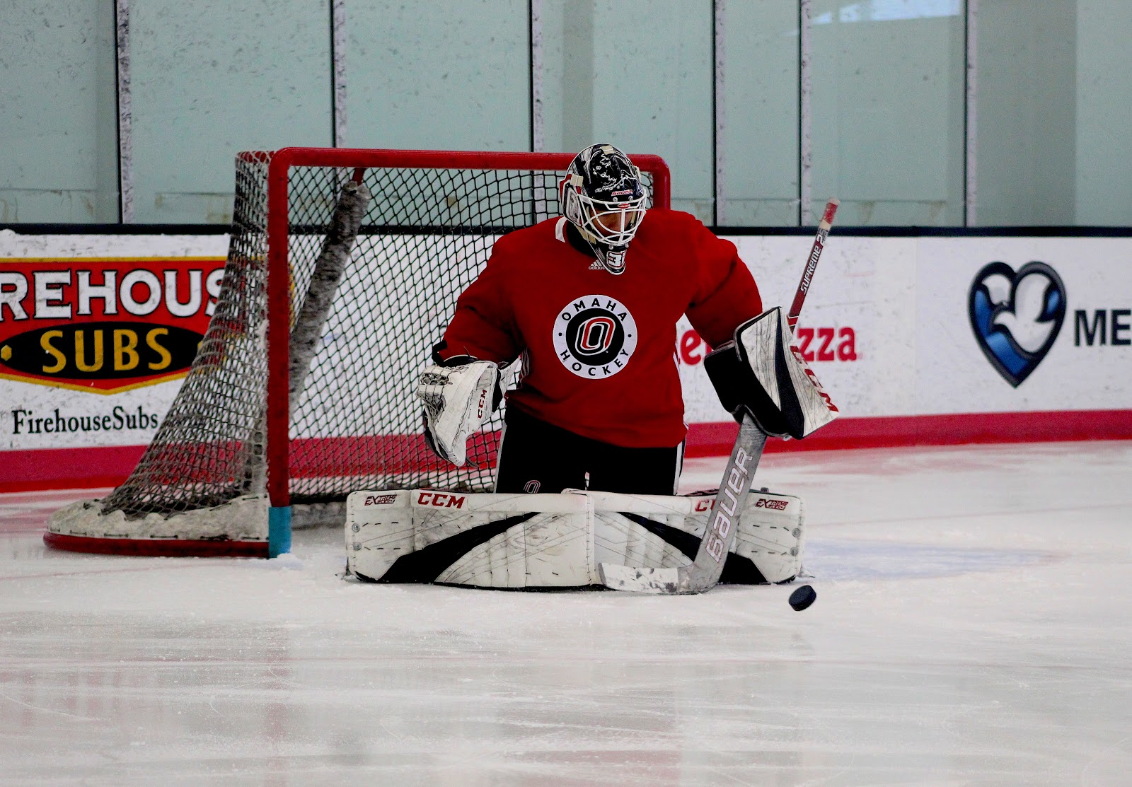The UNO hockey goalkeeper makes a save in practice